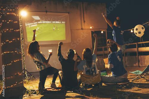 Friends watching a football match Poster
