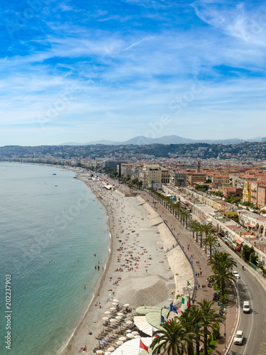 In de dag Nice Luxury resort of French riviera. Beautiful panorama city of Nice in France. Sunny, summer day. Mediterranean sea, public beach, famous quay, palms and houses of Nice