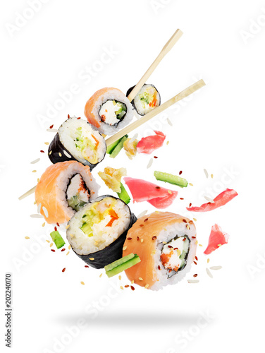 Poster Sushi bar Different fresh sushi rolls with chopsticks frozen in the air on white background