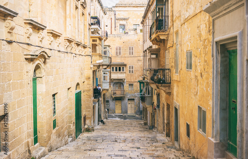 Fototapety, obrazy: Malta, Valletta. Traditional narrow street with stairs in the city center
