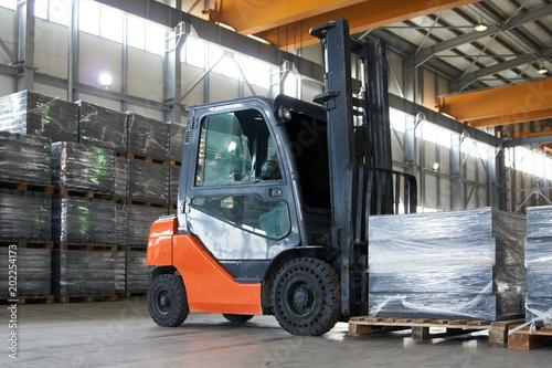 Working Forklift in warehouse. Forklift loader pallet stacker truck equipment at warehouse