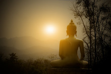 Buddha Statue On The Mountain With Sunset Background