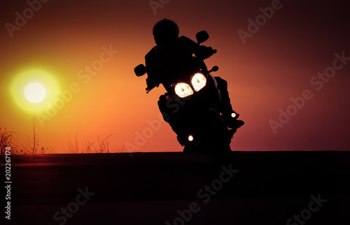 Keuken foto achterwand Vintage cars silhouette of rider on a motorbike driving at sunset - space for your text
