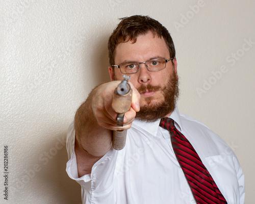 Fényképezés  man pointing a gun