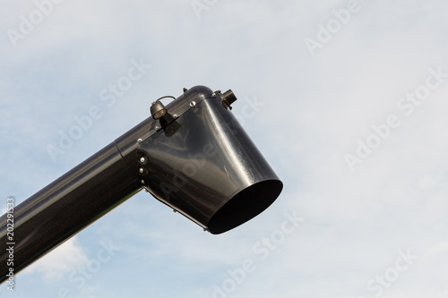 Valokuva  Black chute or drainpipe with sky in background