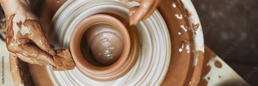 Fototapety, obrazy: A spinning potter's wheel with a vessel. Close-up.