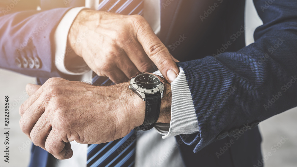 Fototapety, obrazy: Man checking time his watch