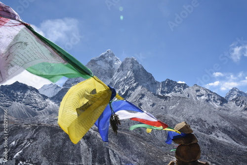 Photo  Praying flag in front of Ama Dablam, Nepal