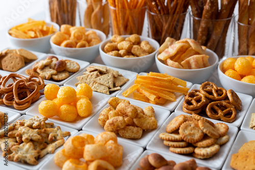 Foto op Canvas Buffet, Bar Rows of many types of savory snacks in white ceramic dishes.