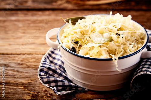Fotografie, Obraz  Bowl of sauerkraut in close up on wooden table