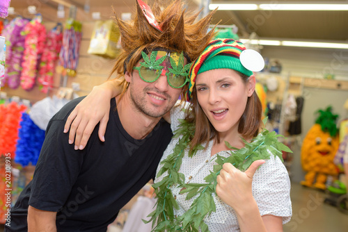 Fotografie, Tablou  portrait of happy couple having fun trying costumes