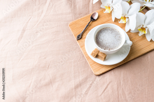 Cozy composition with a Cup of coffee on a tray with sugar on a pastel coffee blanket Flat lay, top view Poster