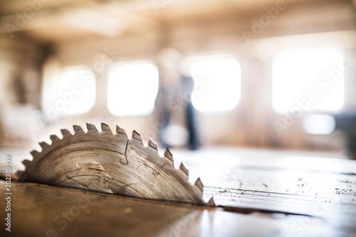 Obraz A circular saw blade in carpentry workshop. - fototapety do salonu