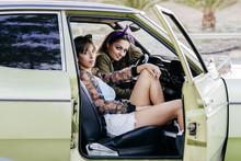 Cool Women Sitting In Muscle Car