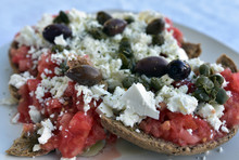 Traditional Greek, Cretan, Barley Rusk Bread Accompanied By Fresh Tomatoes, White Cheese And Black Olives