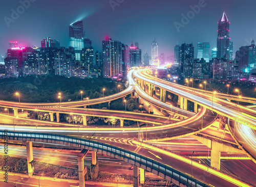 View over the famous highway intersection in Shanghai, China. Modern architecture of a big city. Scenic nighttime skyline.