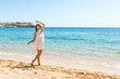Happy carefree woman dancing at the beach. Happy freedom lifestyle concept
