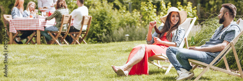 Happy woman relaxing with friend