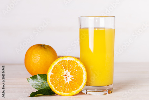 Staande foto Sap glass of orange juice on a table