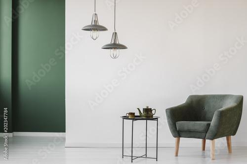 Fotografie, Obraz  Upholstered armchair in minimalist interior
