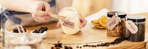 Fotografie, Obraz  Person mixing natural coconut mass