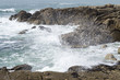 Brittany, France - sea waves with foam and spray roll on the rocky shore