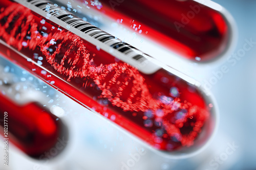 Fotografía  Molecule of DNA forming inside the test tube in the blood test equipment