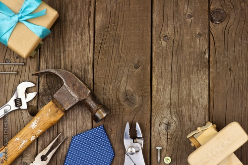 Valokuvatapetti Fathers Day theme corner border of gifts, tie and tools on a rustic wood background