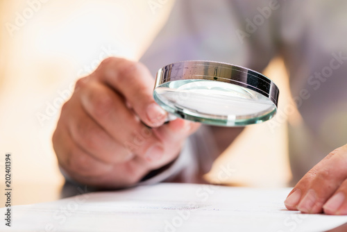 Fotografie, Tablou  Businessman Reading Contract Details Before Signing