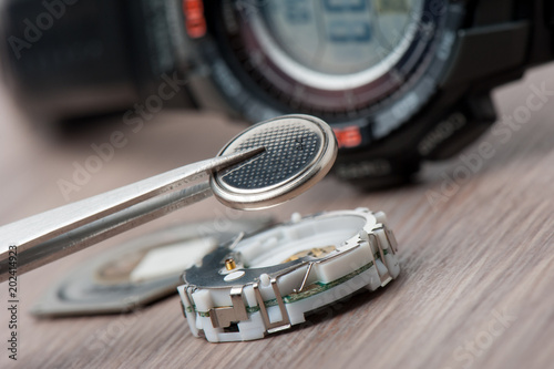 watch battery replacement - Buy this stock photo and explore similar