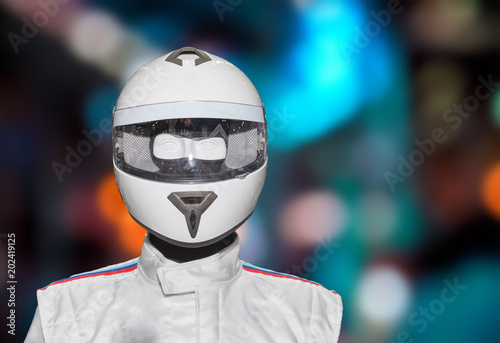 Helmet on the backdrop of a separate machine. Poster