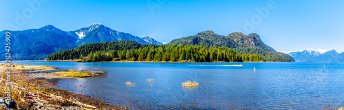 Valokuva  Panorama with a Fishing Boat on Pitt Lake with the Snow Capped Peaks of the Gold