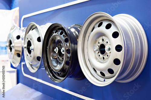 Fotomural  Metal stamped rims for cars in shop