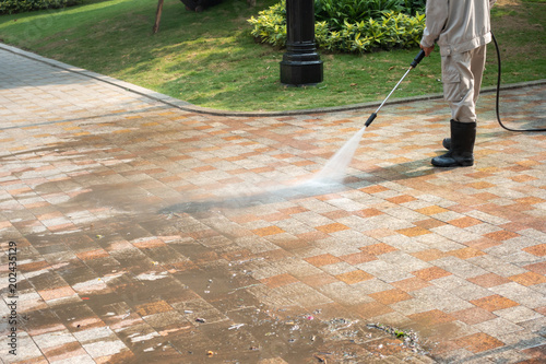 Fotografie, Obraz  Outdoor floor cleaning with a pressure water jet on street