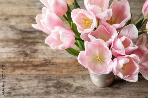 Fototapety, obrazy: Beautiful tulips for Mother's Day on table, top view