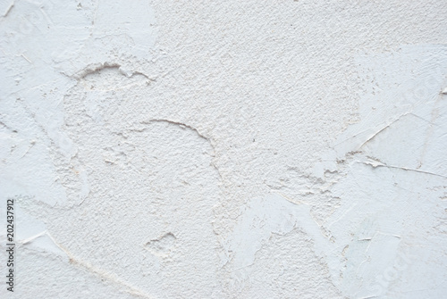 Fotografía  Plaster rough material background. Concrete white wall.
