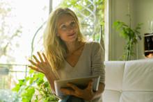 Mature Woman Using Digital Tablet At Home