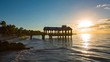 Pier at the beach on sunrise in Key West, Florida USA. Timelapse.