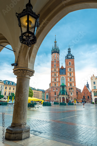 Deurstickers Krakau Vertical postcard view of the main square of Krakow. Mary's church and arch in cloudy weather