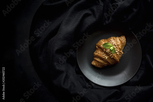 Delicious baked croissants on fabric