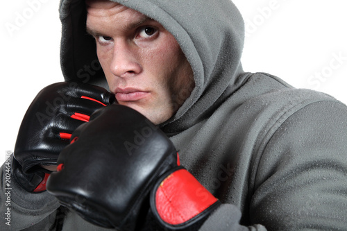 Photo  Powerful fighter in front of white background