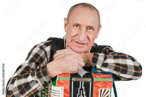 Fényképezés  Portrait of a man, grandfather playing the accordion