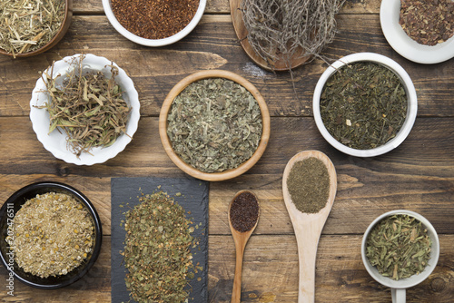 Various herbal infusions on wood, chamimile, mint, rooibos, thyme, green tea, tisane