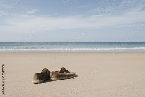 Spain, Cape Trafalgar, shoes at beach