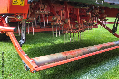 Fotografering  Detail of aeration machine during grasslands football field