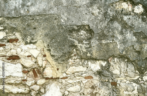 Canvas Prints Old dirty textured wall stone wall covered with clay plaster. Vintage architectural panoramic background
