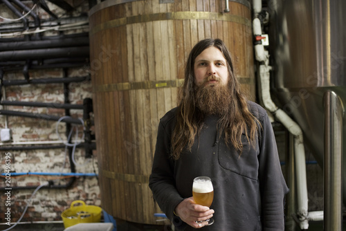 Portrait of a male beer brewer in a brewery