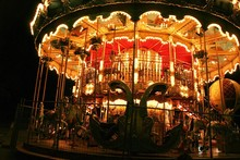Night Fun In Paris Street, Merry-go-round In The Lights Attracting Tourists With Fantasy