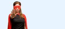 Middle Age Super Hero Woman Wearing Red Mask And Cape Annoyed With Bad Attitude Making Stop Sign With Hand, Saying No, Expressing Security, Defense Or Restriction,  Isolated Blue Background