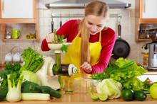 Woman In Kitchen Making Vegeta...